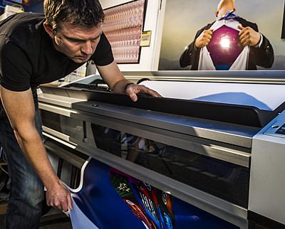 Paul, our print manager using one of the large format printers