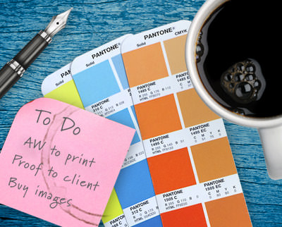 Coffee cup with Pantone booklet and to-do list