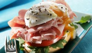 Bagel with runny poached egg and ham