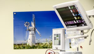 Hospital scanner with printed wall image in focus