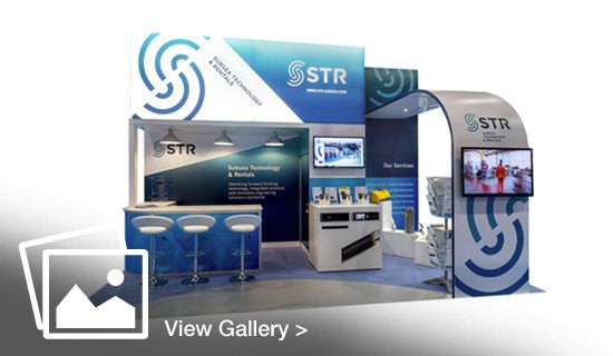 A stand built and designed by GGS featuring a lightbox and bar area