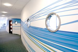 Office Hallway with blue wave graphic on walls