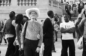 Man wearing fluffy cowgirl hat in street