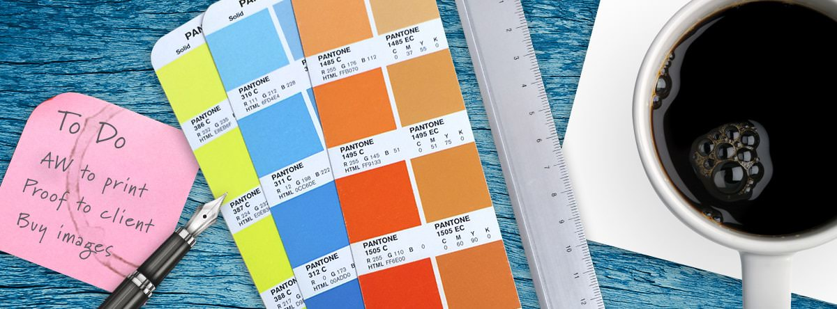 Pantone colour book with to do list and other design supplies
