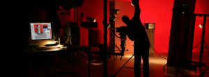 Red studio shot with silhouetted photographer