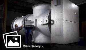 Engineer looking at large machine