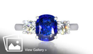 Blue sapphire and diamond silver ring shot on white